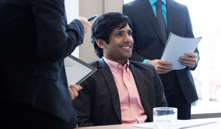 smiling man in meeting